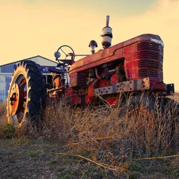 AgroPublic | tractor agriculture machine rural farming plowing equipment rusted plow